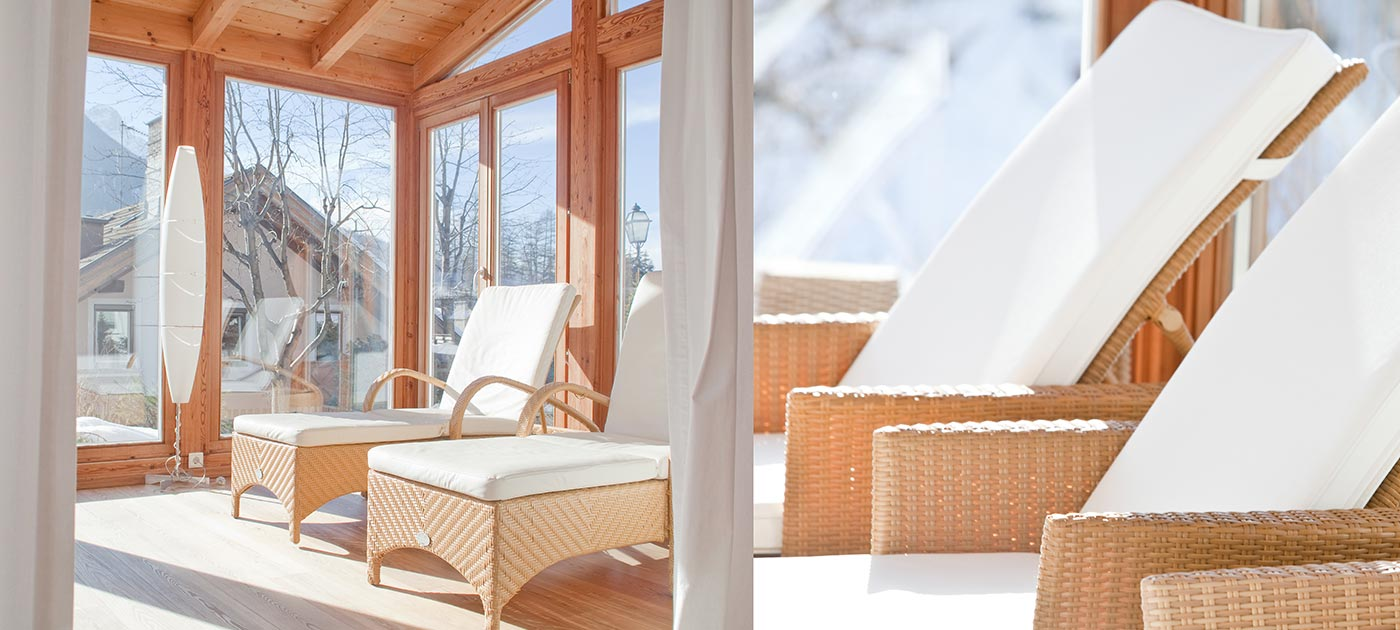 Comfortable wicker beds with white cotton cushions illuminated by sunlight entering the windows of our wellness area